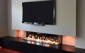 Fireplace design with TV above